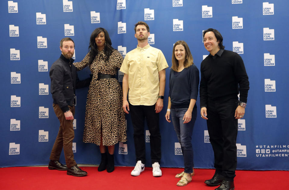 """In this May 3, 2019, photo, from left to right, Aaron Ruell (Kip), Shondrella Avery (LaFawnduh), Jon Heder (Napoleon Dynamite), Emily Dunn (Trisha) and Efren Ramirez (Pedro) pose during a photo-op as they celebrate the 15th anniversary of the cult classic comedy """"Napoleon Dynamite,"""" in Salt Lake City. (AP Photo/Rick Bowmer)"""