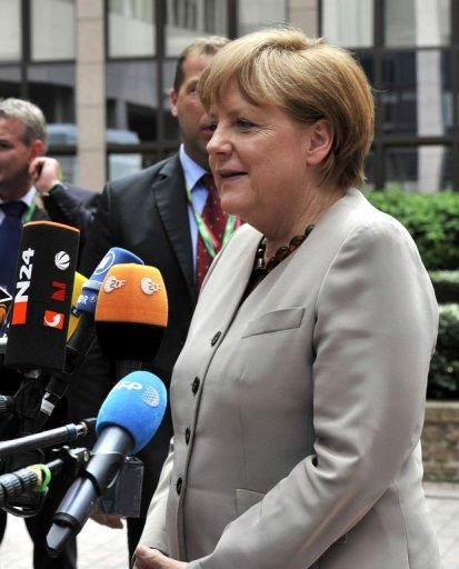 German Chancellor Angela Merkel talks to media upon arrival for a meeting of European Union leaders in Brussels. In a cry for help, Italy and Spain joined forces Thursday, blocking a key EU deal on growth failing swift pledges from their partners to fight off market pressure threatening their economies