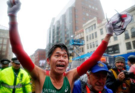 Yuki Kawauchi of Japan celebrates after winning the men's division of the 122nd Boston Marathon in Boston, Massachusetts, U.S., April 16, 2018. REUTERS/Brian Snyder