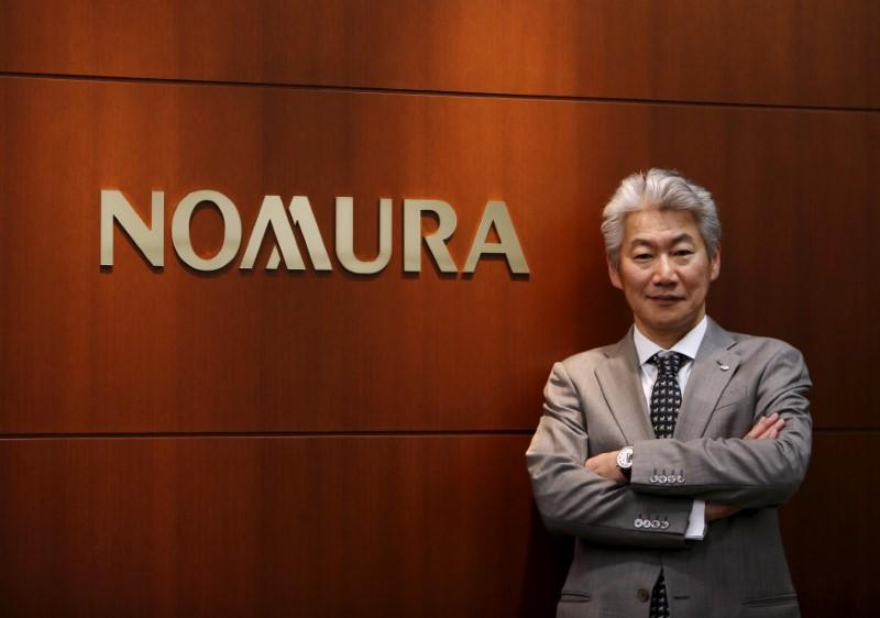 FILE PHOTO: Nomura Holdings' Chief Executive Officer Nagai speaks during an interview with Reuters in Tokyo