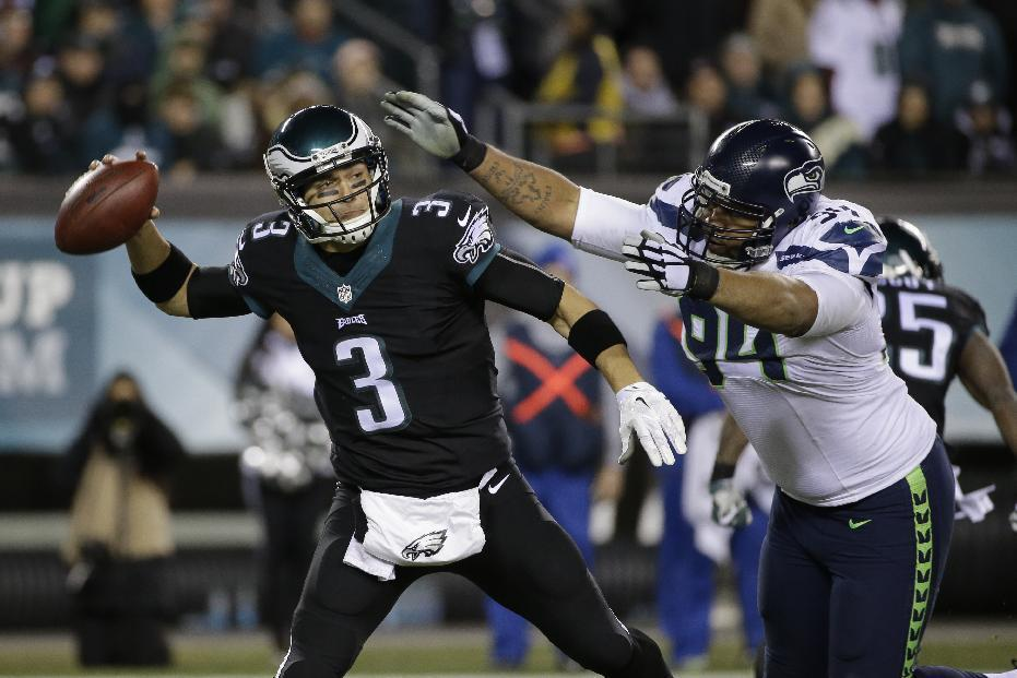 Philadelphia Eagles' Mark Sanchez looks to pass during the second half of an NFL football game against the Seattle Seahawks, Sunday, Dec. 7, 2014, in Philadelphia. (AP Photo/Michael Perez)