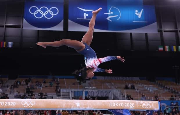 Simone Biles of the United States won bronze in the balance beam final on Tuesday.  (Mike Blake/Reuters - image credit)