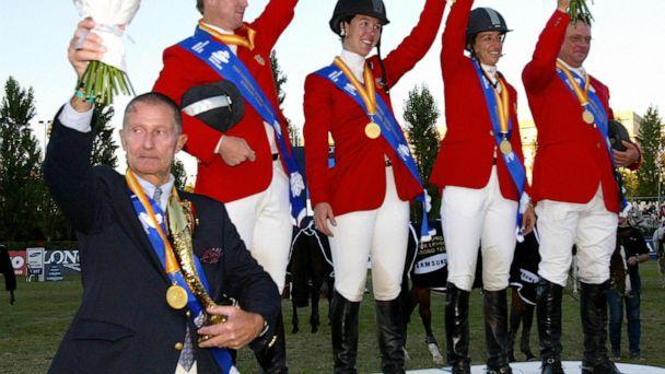 PHOTO: Coach George Morris, left, is seen with Mclain Ward, Lauren Hough, Laura Kraut and Jeffery Welles celebrate after wining the final of the Samsung Super league at the Real Club de Polo in Barcelona, Sept. 18, 2005. (Cesar Rangel/AFP/Getty Images)