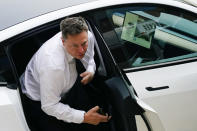 Elon Musk arrives at the justice center in Wilmington, Del., Tuesday, July 13, 2021. Musk took to a witness stand Monday to defend his company's 2016 acquisition of a troubled company called SolarCity against a shareholder lawsuit that claims he's to blame for a deal that was rife with conflicts of interest and never delivered the profits he had promised. (AP Photo/Matt Rourke)