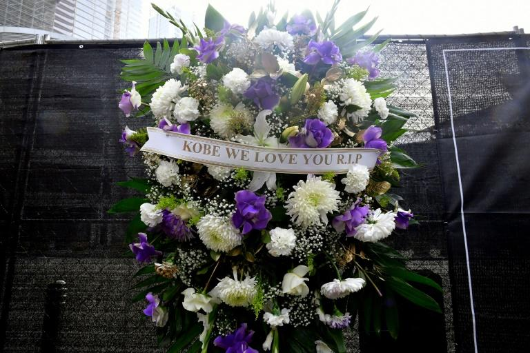 A wreath hangs at the makeshift memorial for former NBA and Los Angeles Lakers player Kobe Bryant, at LA Live Paza in front of the Staples Center in Los Angeles