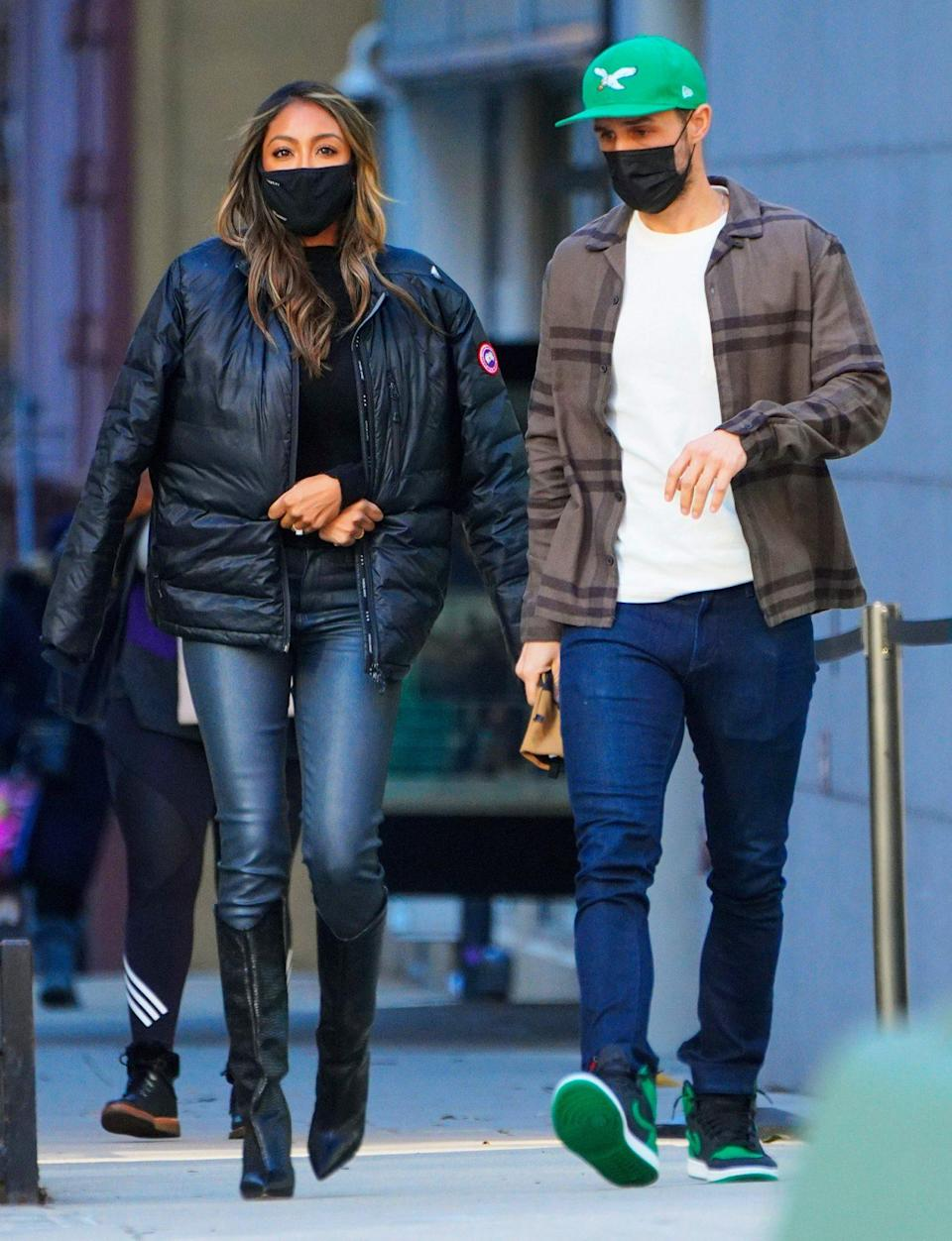 <p>Newly engaged Tayshia Adams and Zac Clark do some shopping in New York City on Monday.</p>