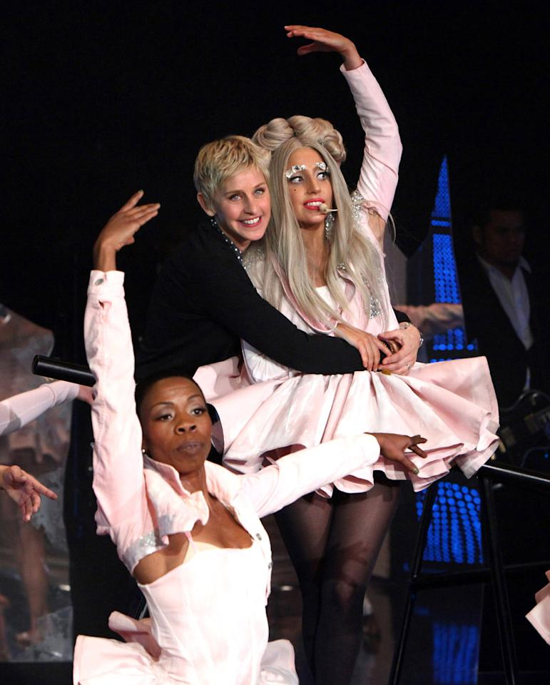 """In this Dec. 5, 2011 photo released by Warner Bros., talk show host Ellen DeGeneres greets Lady Gaga after her performance of """"Marry The Night"""" during a taping of """"The Ellen DeGeneres Show."""" The episode will air on Friday. (AP Photo/Warner Bros., Michael Rozman)"""