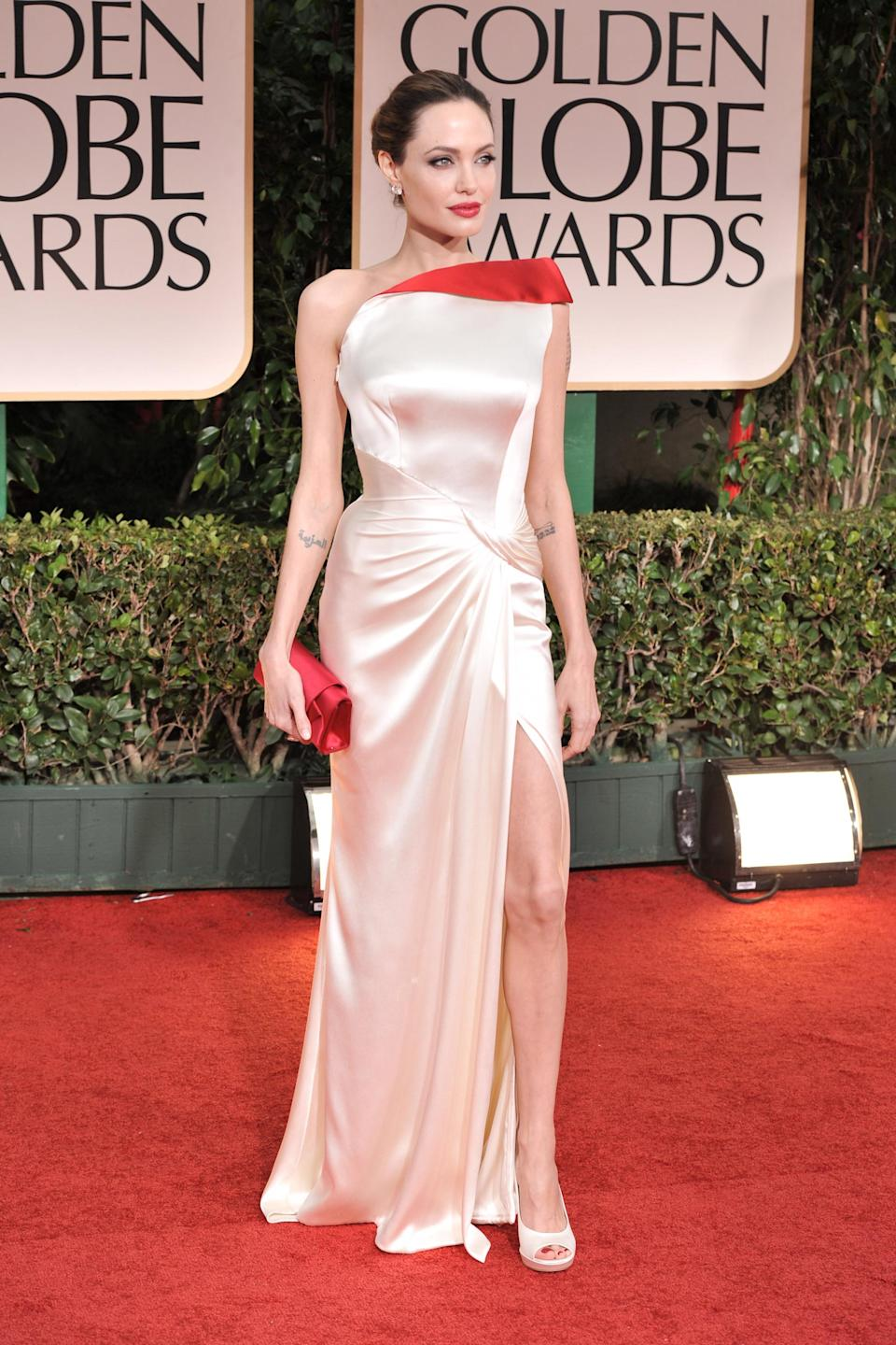 """<strong><h2>2012</h2></strong><br>We've yet to spot Angelina Jolie looking anything short of fabulous on the red carpet circuit, but this show-stopping Atelier Versace gown is hands down her best.<br><br><em>Angelina Jolie in Atelier Versace.</em><span class=""""copyright"""">Photo: George Pimentel/WireImage.</span>"""