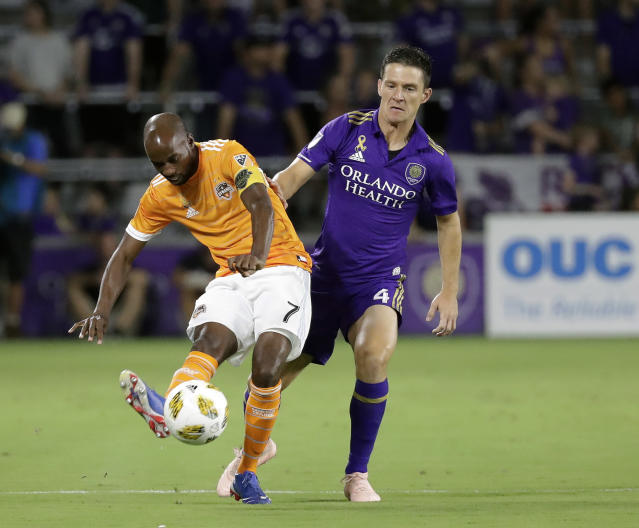 FILE - In this Saturday, Sept. 22, 201 file photo, Houston Dynamo's DaMarcus Beasley (7) moves the ball past Orlando City's Will Johnson (4) during the first half of an MLS soccer match in Orlando, Fla. DaMarcus Beasley is heading into the final stretch of a decorated playing career. The captain of the Houston Dynamo plans to retire at the end of the season. He has no interest in coaching, but he wants to try the management side of the sport he has played for decades. And he thinks he has something to offer, too. (AP Photo/John Raoux, File)