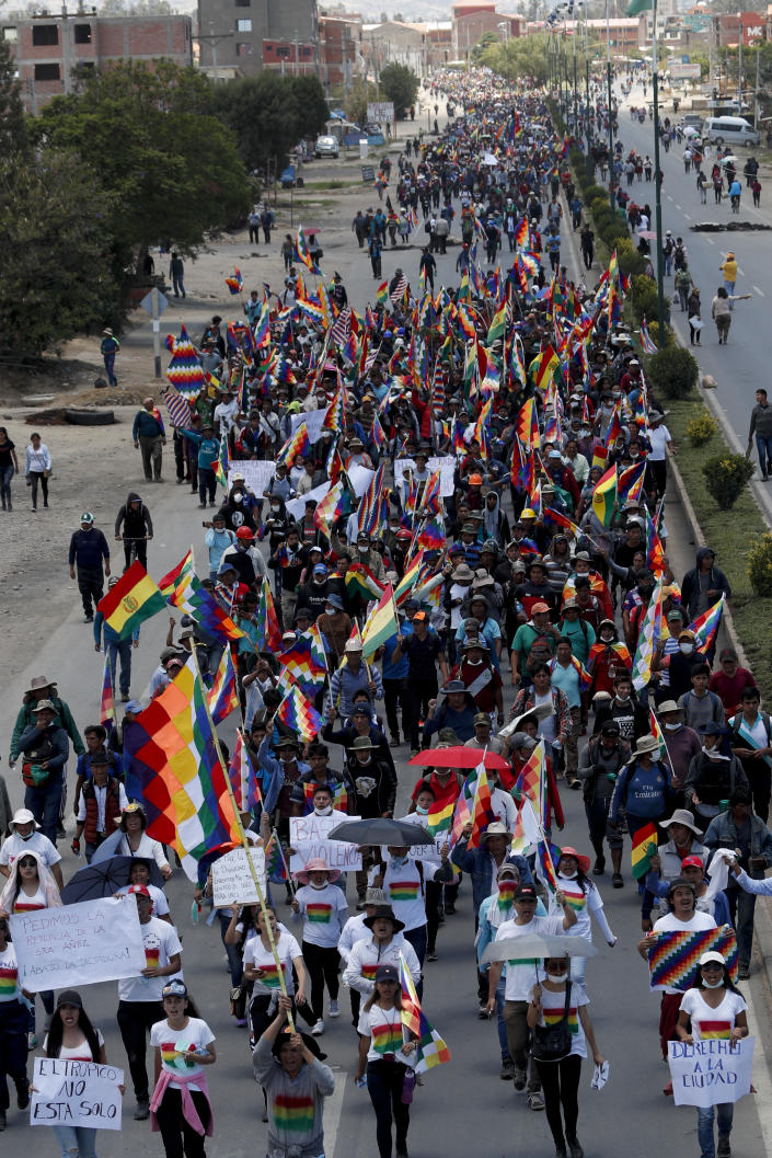 Coca growers, supporters of former President Evo Morales, march in Cochabamba, Bolivia, Monday, Nov. 18, 2019. Morales backers have taken to the streets since he resigned on Nov. 10 under pressure from the military after weeks of protests against him over disputed election results. (AP Photo/Juan Karita)