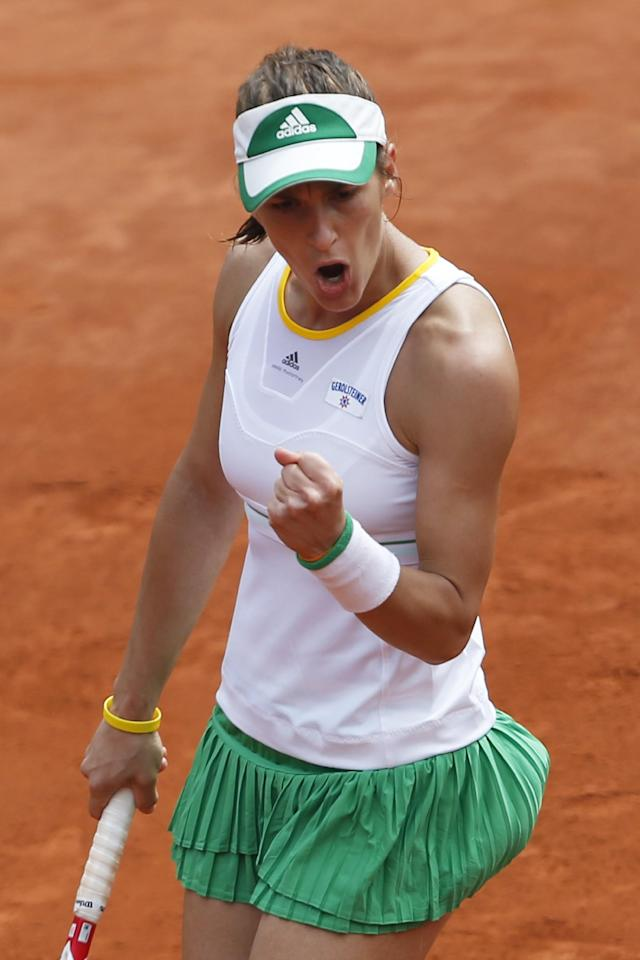 Germany's Andrea Petkovic clenches her fist after scoring during the fourth round match of the French Open tennis tournament against Netherlands' Kiki Bertens at the Roland Garros stadium, in Paris, France, Monday, June 2, 2014. (AP Photo/Michel Spingler)