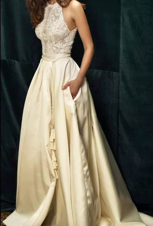 Image of woman modelling wedding gown with curtain tassel belt