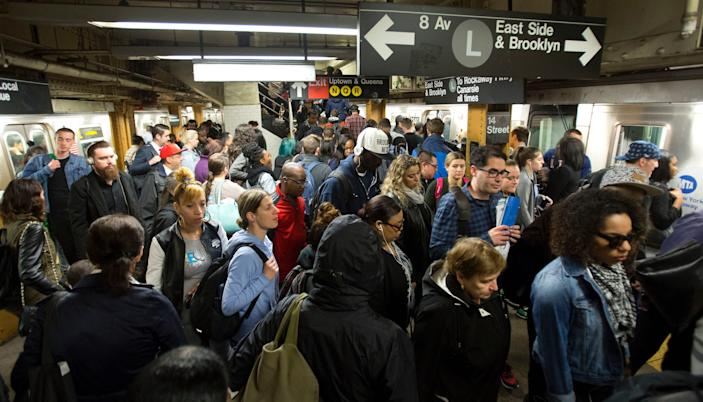 Commuters work their way across a crowded subway platform in New York.
