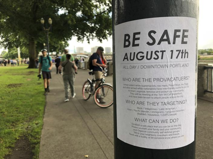 """A posted sign reads """"Be Safe. August 17th"""" is posted in Portland, Ore., Saturday, Aug. 17, 2019.  Right-wing groups and counterprotesters gathered in downtown Portland, Oregon, on Saturday and authorities set up concrete barriers and closed streets in an effort to contain the groups. (AP Photo/Gillian Flaccus)"""
