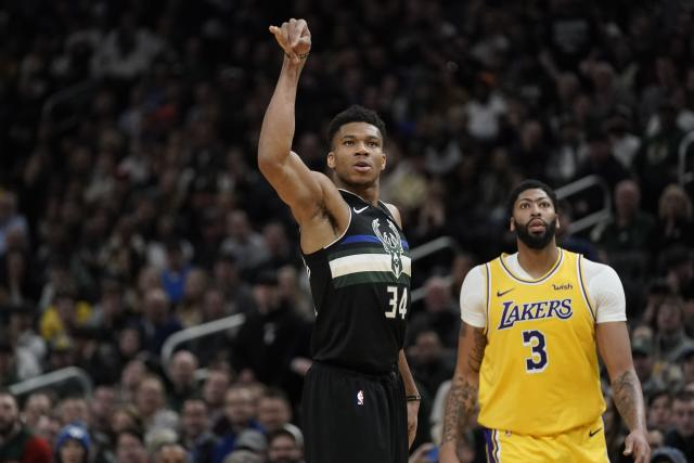 Giannis Antetokounmpo hit five 3-pointers against Anthony Davis and the Lakers on Thursday night. (AP Photo/Morry Gash)