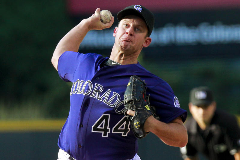 Colorado Rockies starting pitcher Roy Oswalt throws to a Los Angeles Dodgers batter during the first inning of a baseball game Tuesday, July 2, 2013, in Denver. (AP Photo/Barry Gutierrez)