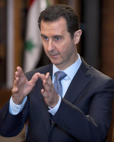 In this photo released by the Syrian official news agency SANA, Syrian President Bashar Assad speaks during an interview in Damascus, Syria, Sunday, Jan. 19, 2014. Syria has been ruled by President Bashar Assad's family since 1970, and Iran is Assad's strongest regional ally, supplying his government with advisers, money and materiel since the uprising began in 2011. (AP Photo/SANA)