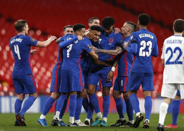 Ollie Watkins (centre) wrapped up the scoring with a debut goal