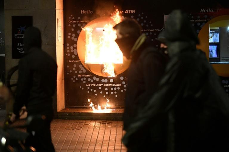 A burning cash machine in Barcelona during the protest