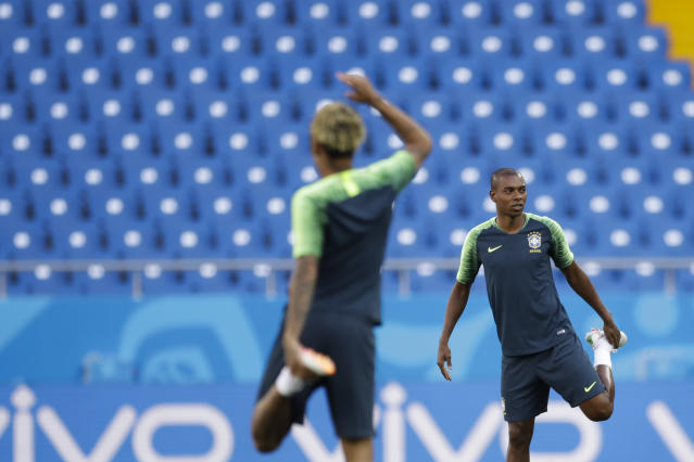Brazil's Fernandinho, right, and Neymar, stretch their legs during Brazil's official training on the eve of the group E match between Brazil and Switzerland at the 2018 soccer World Cup in the Rostov Arena in Rostov-on-Don, Russia, Saturday, June 16, 2018. (AP Photo/Felipe Dana)