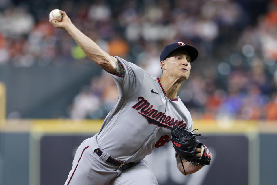 Minnesota Twins starting pitcher Griffin Jax throws to a Houston Astros batter during the first inning of a baseball game Thursday, Aug. 5, 2021, in Houston. (AP Photo/Michael Wyke)