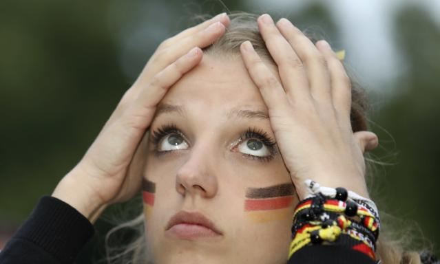 Soccer Football - World Cup - Group F - Germany vs Sweden - Berlin, Germany - June 23, 2018 Germany soccer fan watches match at public viewing area at Brandenburg Gate. REUTERS/Christian Mang