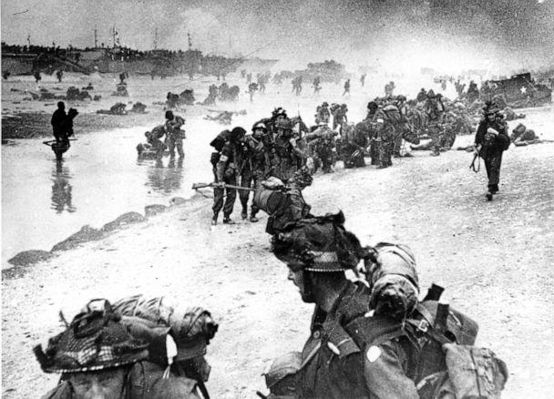 PHOTO: Wounded British troops from the South Lancashire and Middlesex regiments are being helped ashore at Sword Beach, June 6, 1944, during the D-Day invasion of German occupied France during World War II. (British Navy via AP)