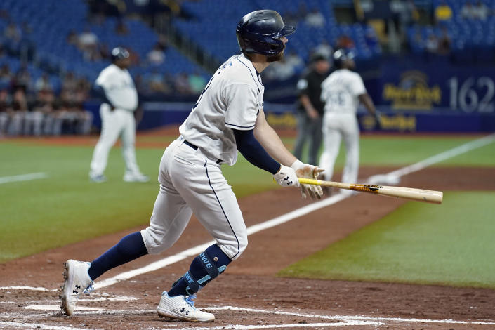 Tampa Bay Rays' Brandon Lowe follows the flight of his two-run home run off Baltimore Orioles starting pitcher Keegan Akin during the fourth inning of a baseball game Friday, June 11, 2021, in St. Petersburg, Fla. (AP Photo/Chris O'Meara)