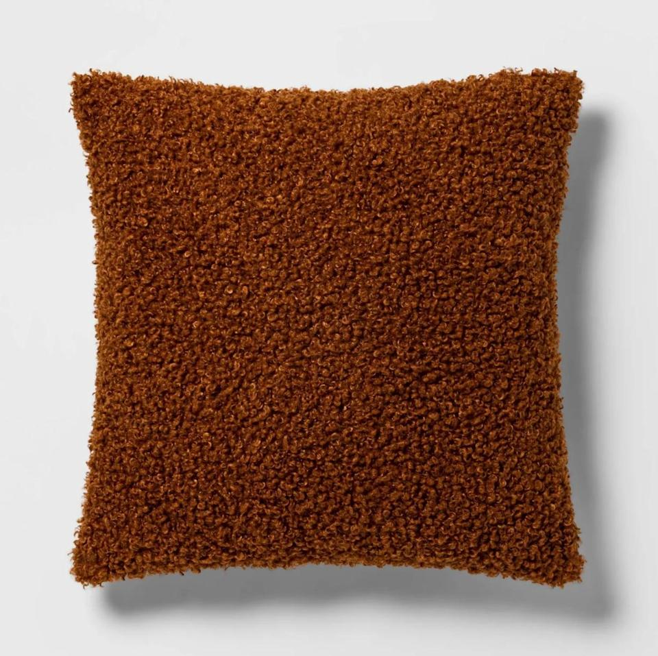 <p>She can dress up her living room couch or swivel chair with this <span>Threshold Euro Boucle Decorative Throw Pillow</span> ($30). From the tactile, bouclé fabric to the burnt-orange hue, this pick is basically fall in a pillow.</p>