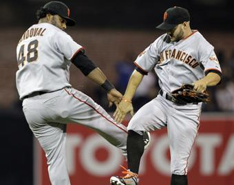 Pablo Sandoval (left) and Cody Ross celebrate San Francisco's 6-4 win over San Diego on Tuesday. With a second wild card, the Giants would be in the thick of the NL playoff chase