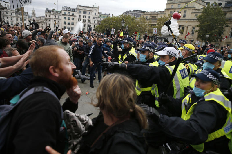 "LONDON, ENGLAND - SEPTEMBER 26: Protesters clash with police officers during a ""We Do Not Consent"" anti-lockdown rally at Trafalgar Square on September 26, 2020 in London, England. Thousands of anti-mask demonstrators protested in Trafalgar Square after the British government imposed tighter coronavirus laws this week. (Photo by Hollie Adams/Getty Images)"
