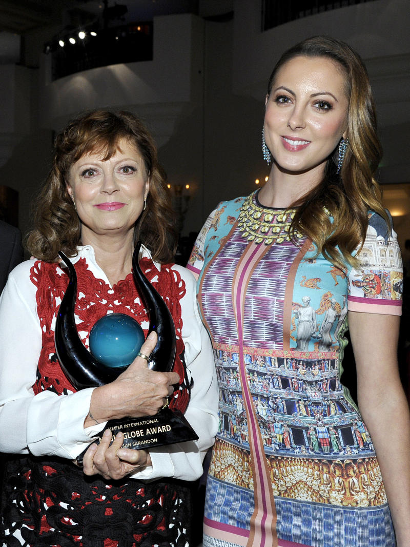 "LOS ANGELES, CA - SEPTEMBER 19: Honoree Susan Sarandon poses with the Noble Globe Award (L) and daughter Eva Amurri Martino during Heifer International's 2nd Annual ""Beyond Hunger: A Place at the Table"" to Help End World Hunger and Poverty at Montage Hotel on September 19, 2013 in Los Angeles, California. (Photo by John Sciulli/Getty Images for Heifer International)"