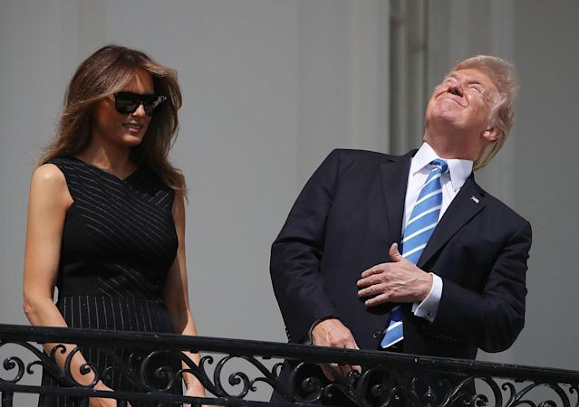 """<p>AUG. 21, 2017 – President Donald Trump looks up toward the Solar Eclipse while joined by his wife first lady Melania Trump on the Truman Balcony at the White House on in Washington, DC. Millions of people have flocked to areas of the U.S. that are in the """"path of totality"""" in order to experience a total solar eclipse. (Photo: Mark Wilson/Getty Images) </p>"""