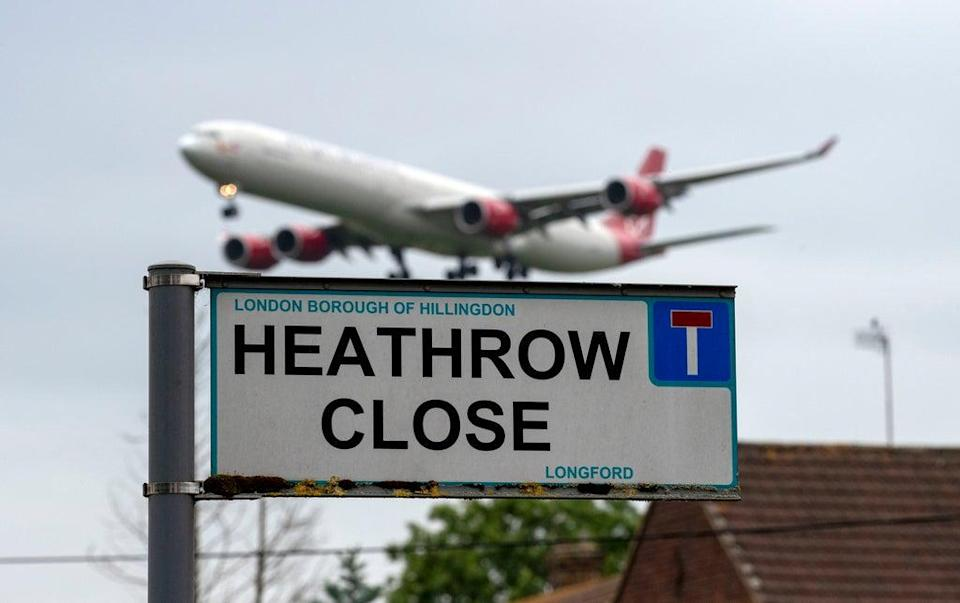 A plane landing at Heathrow Airport (PA) (PA Archive)