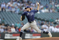 Tampa Bay Rays starting pitcher Josh Fleming works against the Seattle Mariners during the first inning of a baseball game Saturday, June 19, 2021, in Seattle. (AP Photo/John Froschauer)