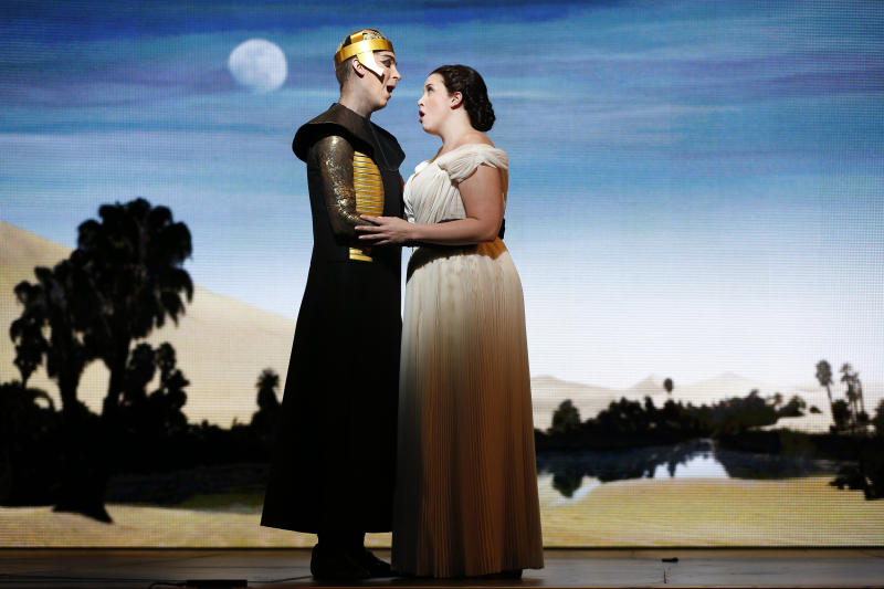 """In this April 12, 2013 photo provided by the New York City Opera, tenor Randall Bills, as Pharaoh's son, Osiride, performs with soprano Sian Davies as Elcia during the New York City Opera's final dress rehearsal of Rossini's rarely performed """"Mose in Egitto (Moses in Egypt),"""" at the City Center in New York. (AP Photo/New York City Opera, Carol Rosegg)"""