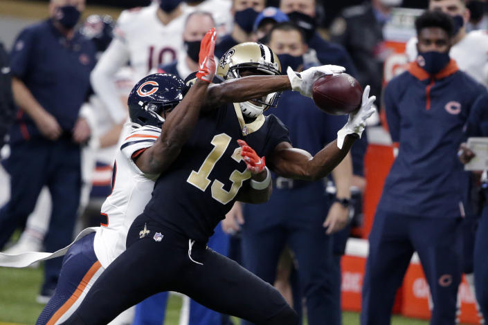 New Orleans Saints wide receiver Michael Thomas (13) pulls in a pass against Chicago Bears cornerback Kindle Vildor in the first half of an NFL wild-card playoff football game in New Orleans, Sunday, Jan. 10, 2021. (AP Photo/Butch Dill)