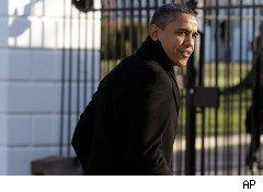 President Barack Obama walks back to the White House after his meeting with business leaders Wednesday.