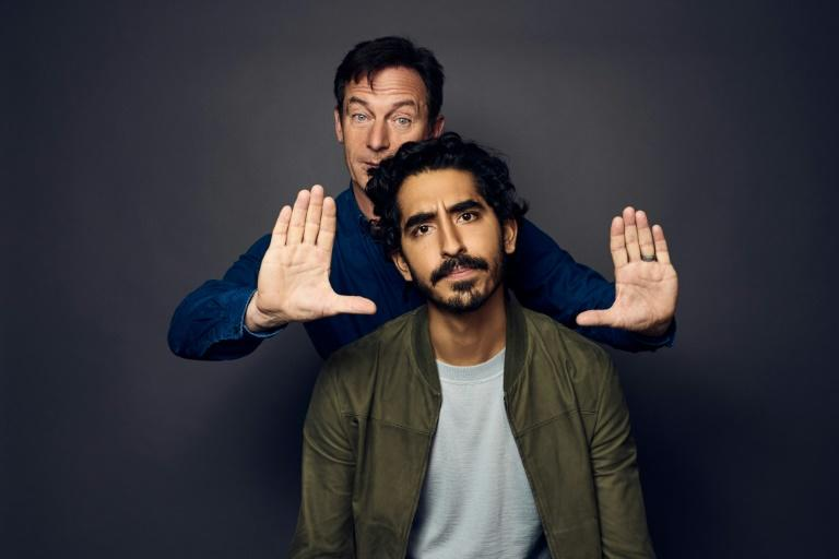 TORONTO - SEPTEMBER 07: Actors Jason Isaacs and Dev Patel from the film 'Hotel Mumbai' pose for a portrait during the 2018 Toronto International Film Festival