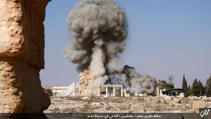 An undated image, which appears to be a screenshot from a video and which was published by the Islamic State group on August 25, 2015, allegedly shows smoke billowing from the Baal Shamin temple in Palmyra, Syria (AFP Photo/)