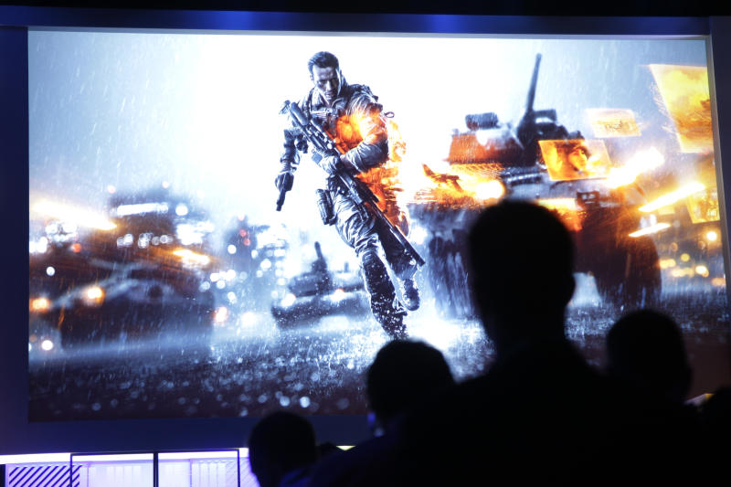 Attendees watch a presentation on video game Battlefield 4 at the Microsoft Xbox E3 media briefing in Los Angeles, Monday, June 10, 2013. Microsoft focused on how cloud computing will make games for its next-generation Xbox One console more immersive during its Monday presentation at the Electronic Entertainment Expo. Microsoft announced last week that the console must be connected to the Internet every 24 hours to operate, and the system would ideally always be online. (AP Photo/Jae C. Hong)