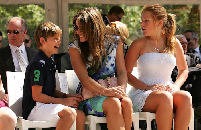 MELBOURNE, AUSTRALIA - DECEMBER 22:  (L to R) Damian Hurley, Elizabeth Hurley and Brooke Warne look on during the unveiling of the Shane Warne statue at the Melbourne Cricket Ground on December 22, 2011 in Melbourne, Australia.  (Photo by Scott Barbour/Getty Images)