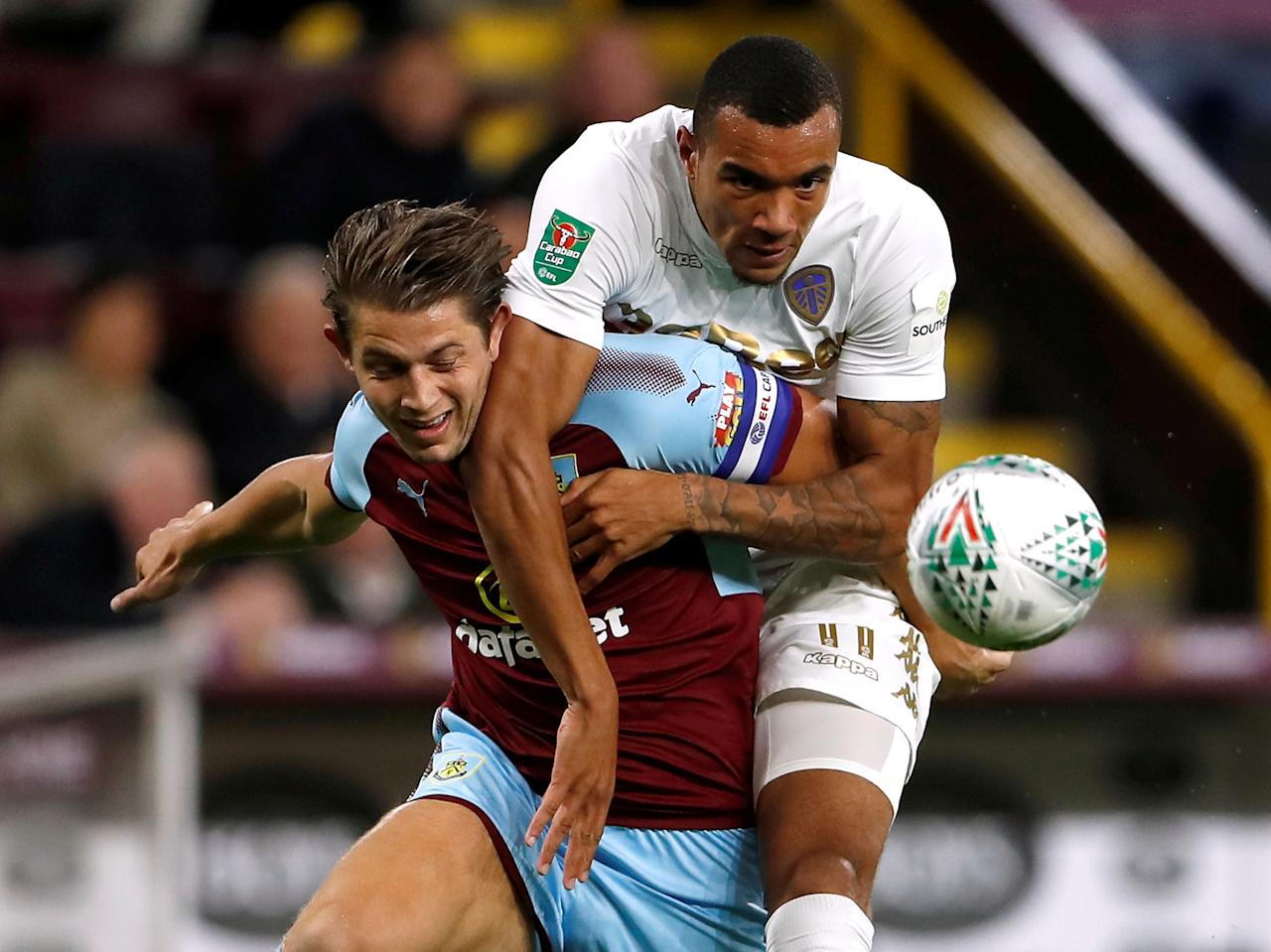 "Soccer Football - Carabao Cup Third Round - Burnley vs Leeds United - Turf Moor, Burnley, Britain - September 19, 2017   Burnley's  James Tarkowski in action with Leeds United's Jay-Rot Grot    Action Images via Reuters/Lee Smith   EDITORIAL USE ONLY. No use with unauthorized audio, video, data, fixture lists, club/league logos or ""live"" services. Online in-match use limited to 75 images, no video emulation. No use in betting, games or single club/league/player publications. Please contact your account representative for further details.     TPX IMAGES OF THE DAY"