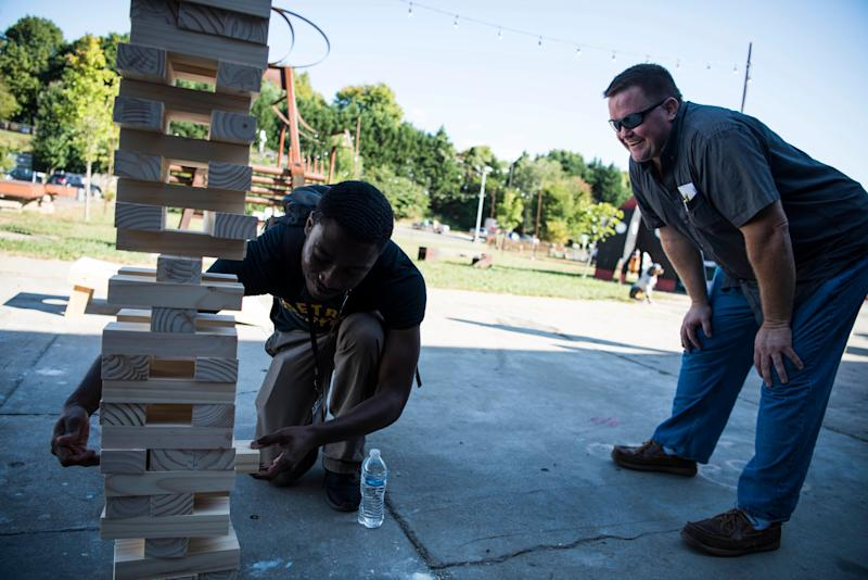 Raymond Goffin and Phil Lewis play Jumbo Jenga during HuffPost's visit to IX Art Park.