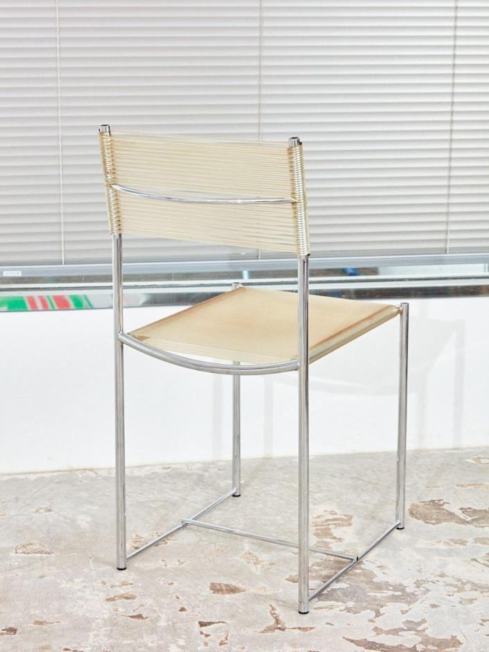 """Please buy this pair of vintage 1970s Italian Spaghetti Chairs by Giandomenico Belotti for Alias. You could park them at your dining table or have one in your living room, either way, the comfortable and rare-chrome-and-PVC piece will be a source of pride. $300, Coming Soon. <a href=""""https://comingsoonnewyork.com/products/spaghetti-chair"""" rel=""""nofollow noopener"""" target=""""_blank"""" data-ylk=""""slk:Get it now!"""" class=""""link rapid-noclick-resp"""">Get it now!</a>"""