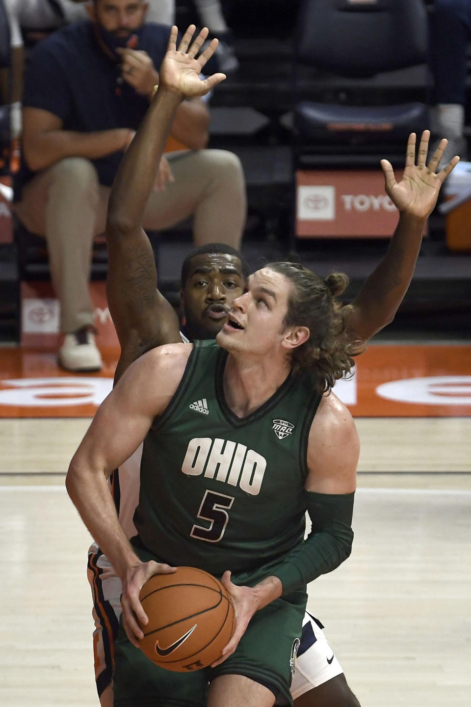 Ohio forward Ben Vander Plas (5) shoots as Illinois guard Da'Monte Williams (20) defends in the first half of an NCAA college basketball game Friday, Nov. 27, 2020, in Champaign, Ill. (AP Photo/Holly Hart)