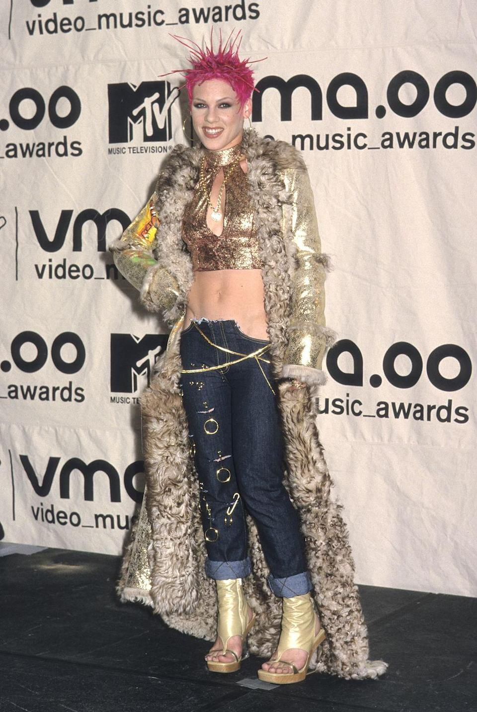 <p>The singer attended the MTV VMAs sporting a cropped halter, floor-length fur coat, and jeans that maybe had earrings hanging on them? A bright-pink 'do also happened, naturally.</p>
