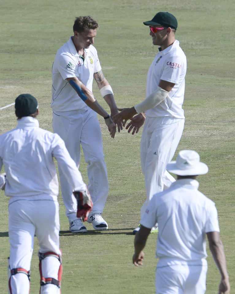 South African bowler Dale Steyn (L) is congratulated by teammates for the dismissal of Pakistan batsman Sarfraz Ahmed during the third day of the third Test match between South Africa and Pakistan on February 24, 2013 at Super Sport Park in Centurion. AFP PHOTO / STEPHANE DE SAKUTIN        (Photo credit should read STEPHANE DE SAKUTIN/AFP/Getty Images)