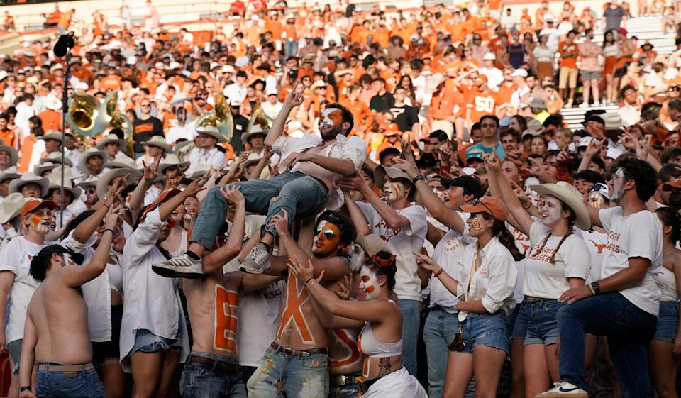Longhorns fans celebrate in the second half against the Ragin' Cajuns.