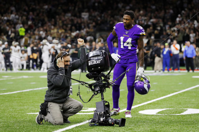 Vikings' receiver Stefon Diggs looks on as a technician tends to the SkyCam. (Kevin C. Cox/Getty Images)